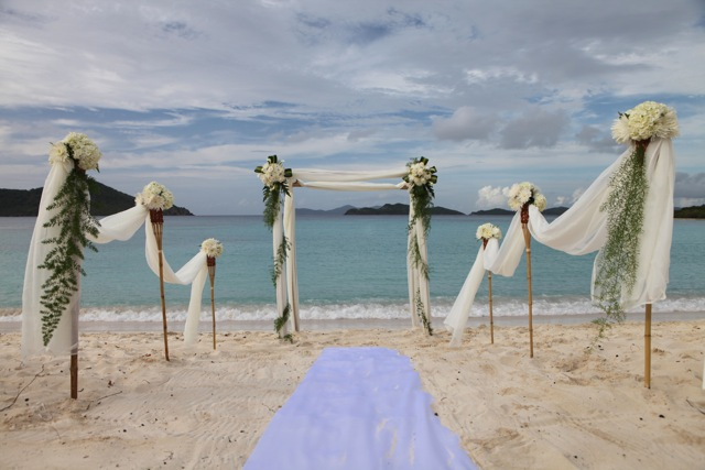 palm arches for a beach wedding